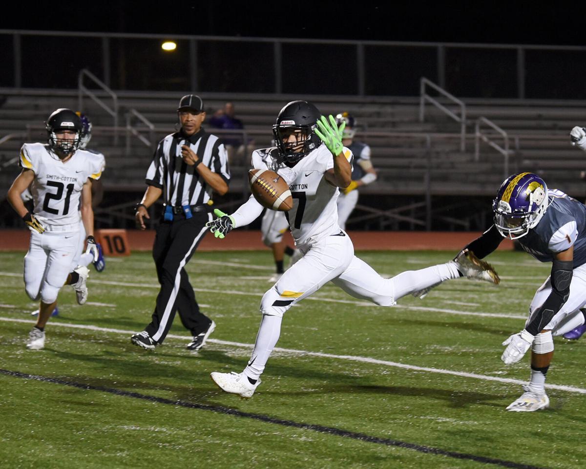 Smith-Cotton High School junior Josiah Oliver fumbles