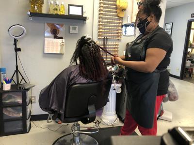 Black hair salons help spread COVID-19 vaccine information