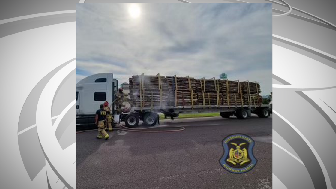 Wood on semi catches fire after cigarette thrown out window
