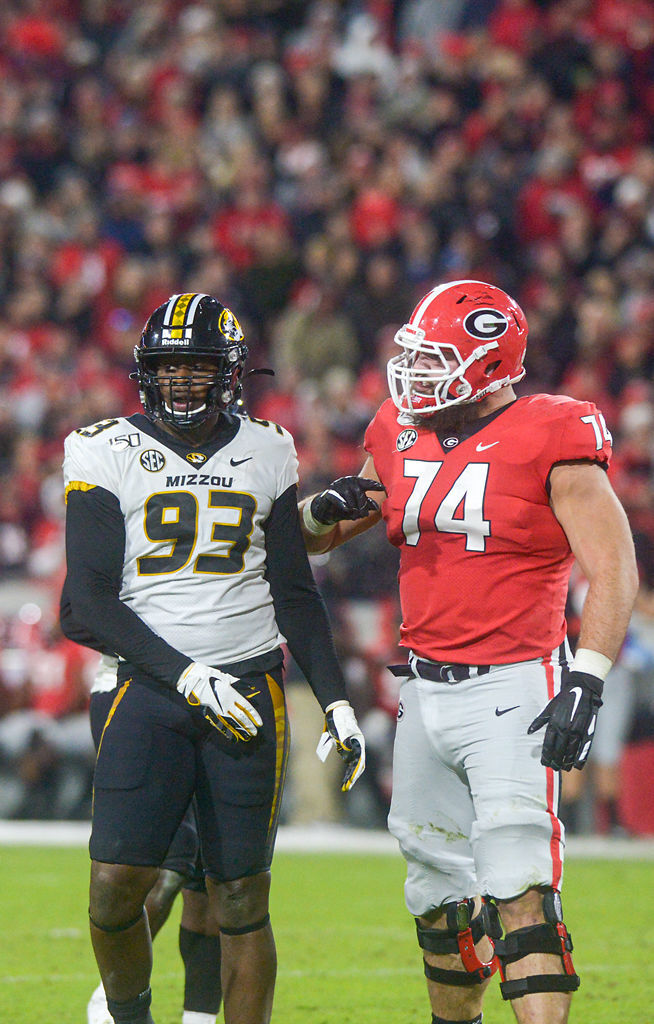 Missouri defensive lineman Tre Williams stands next to Georgia offensive lineman Ben Cleveland