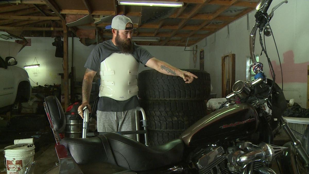 Christian Bullard with his bike a week after the crash