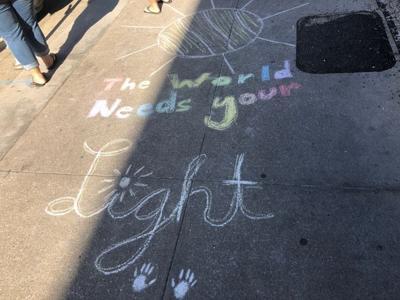 Kids take to sidewalks to write uplifting quotes in Columbia