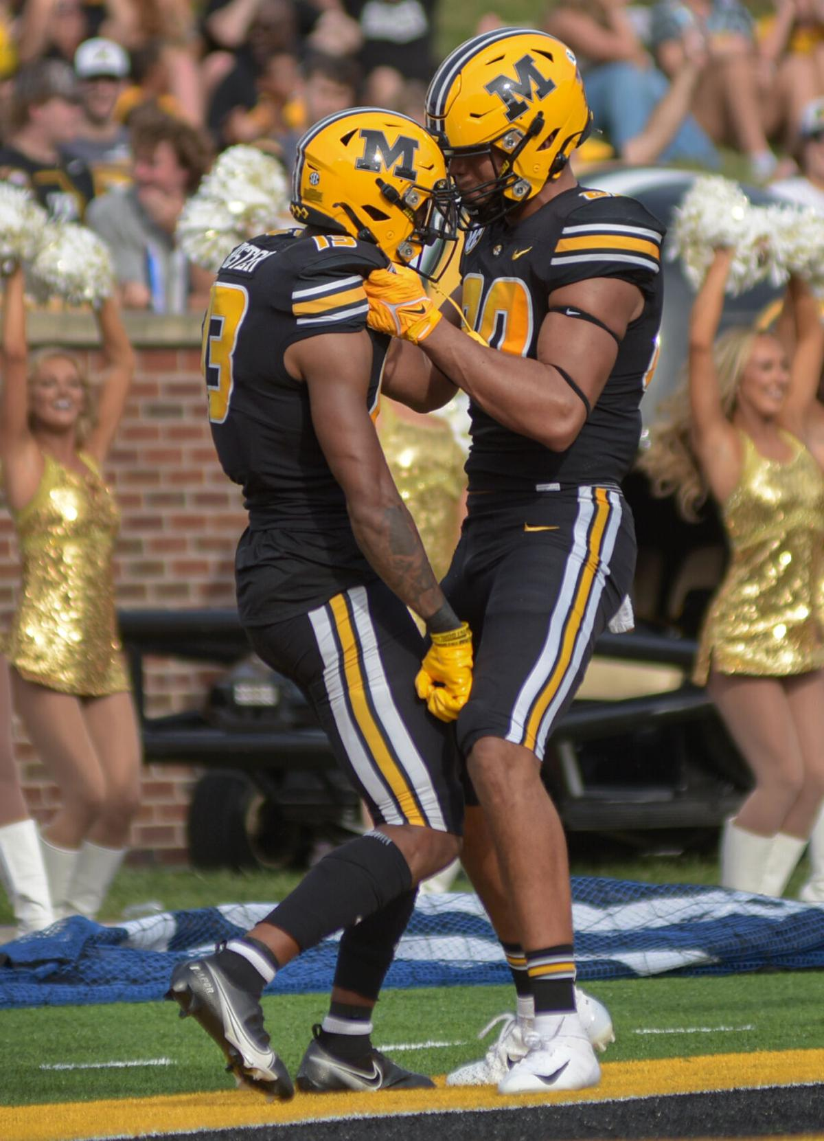 JJ Hester, left and Messiah Whiteside celebrate after a touchdown Saturday at the Faurot Field at Memorial Stadium.