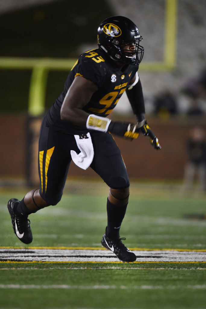 Missouri defensive end Tre Williams moves around the Wyoming
