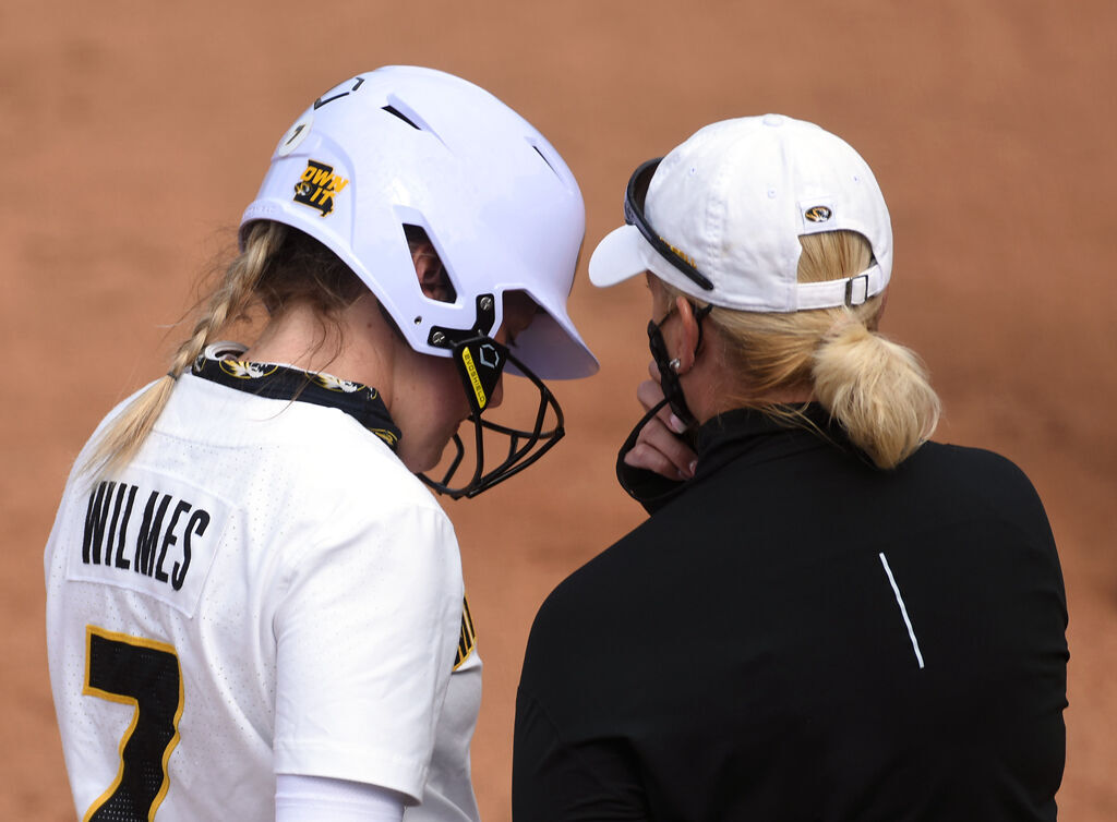 Outfielder Brooke Wilmes listens to coach Larissa Anderson