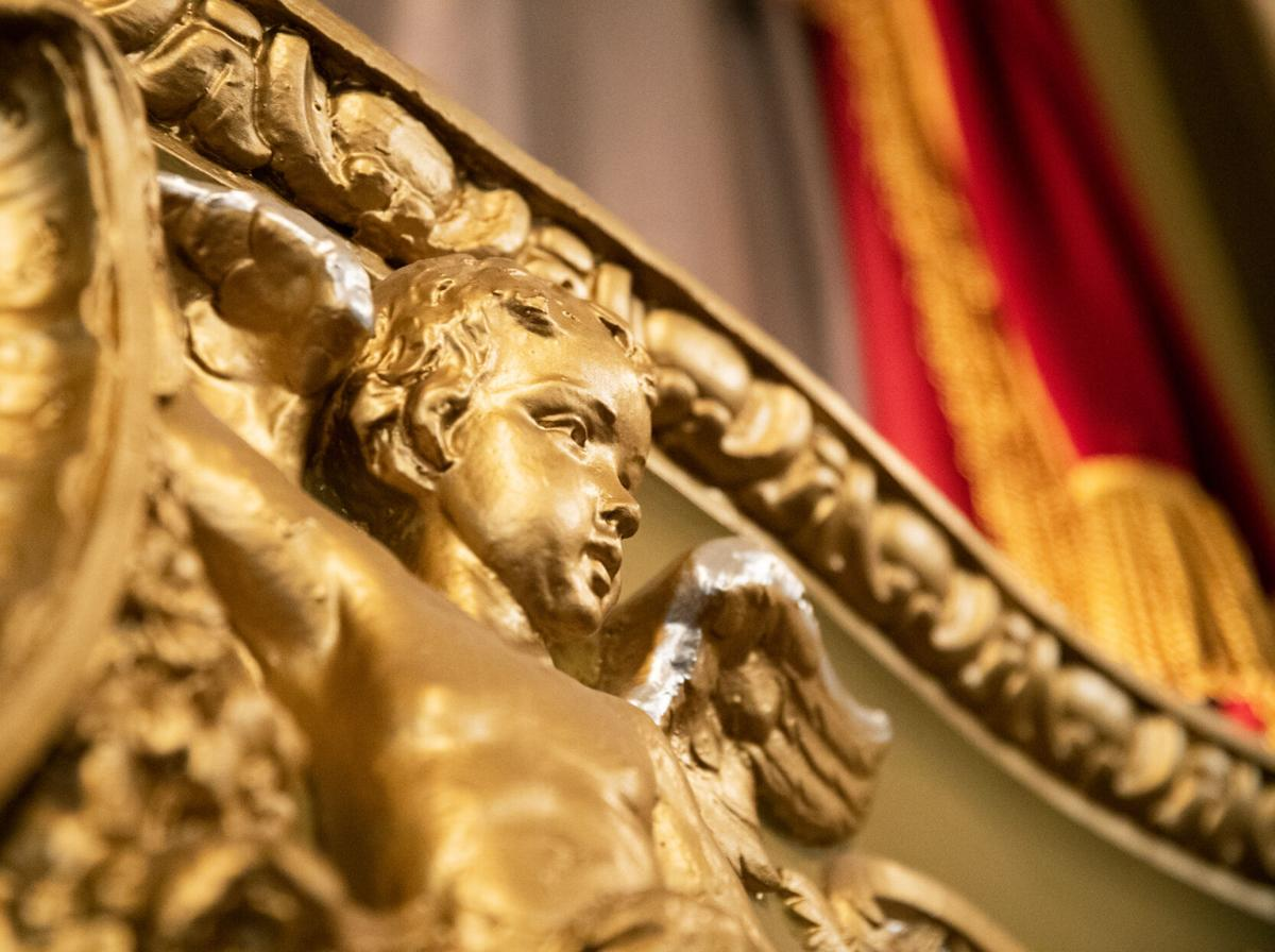 Golden angels are displayed along the walls
