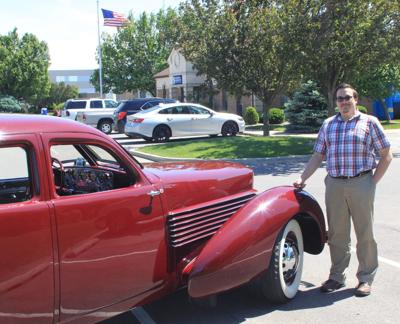 Museum curator Sam Grate with Cord auto