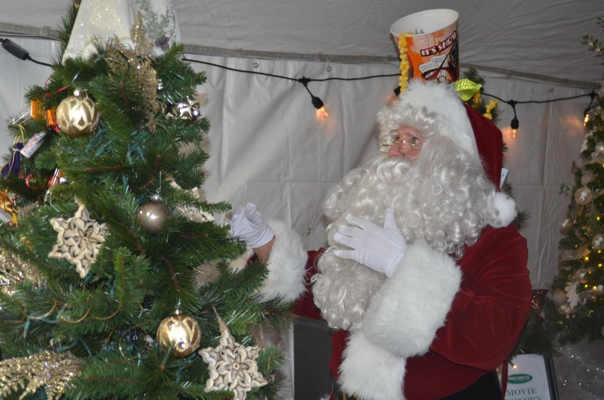 Santa Claus helps with the auction