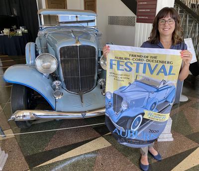 Leslie Peel, ACD Festival executive director, with 2020 festival flag