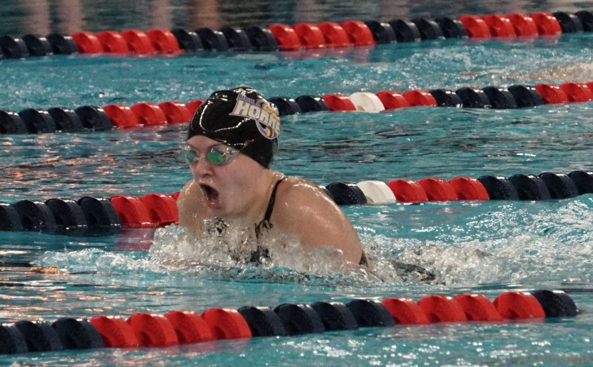 Simmons competes in the 200 medley