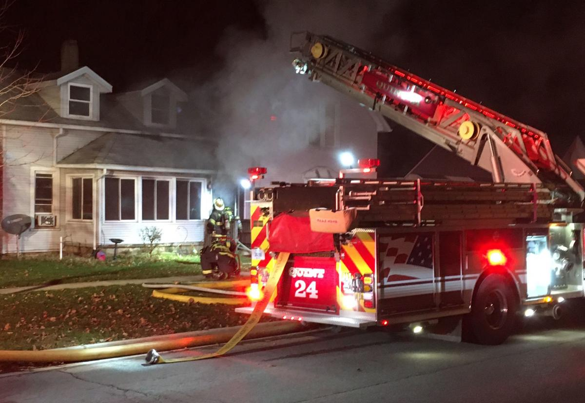 Smoke pours from east Auburn home