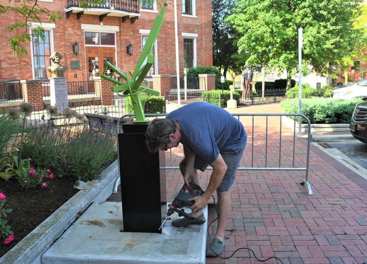 Nathan Pierce installs his sculpture in Angola