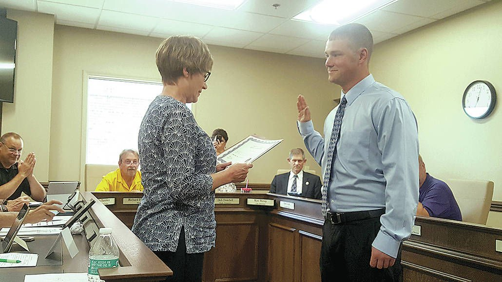 Officers sworn in, ordinance passed and abatements approved