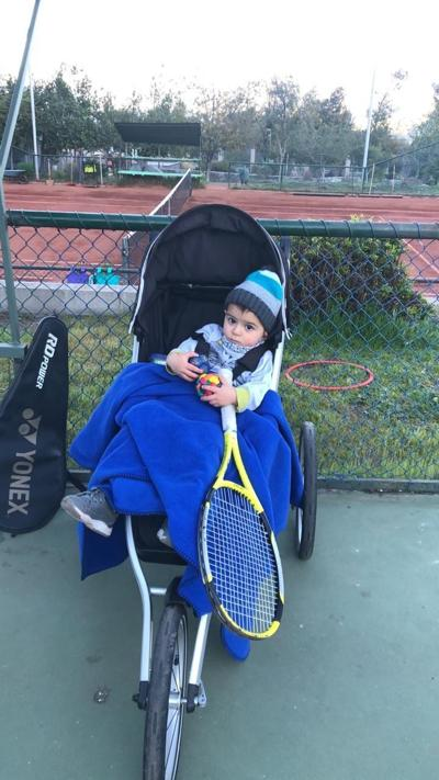 Oliver with tennis racket