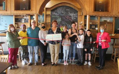 Knight and Day ribbon cutting