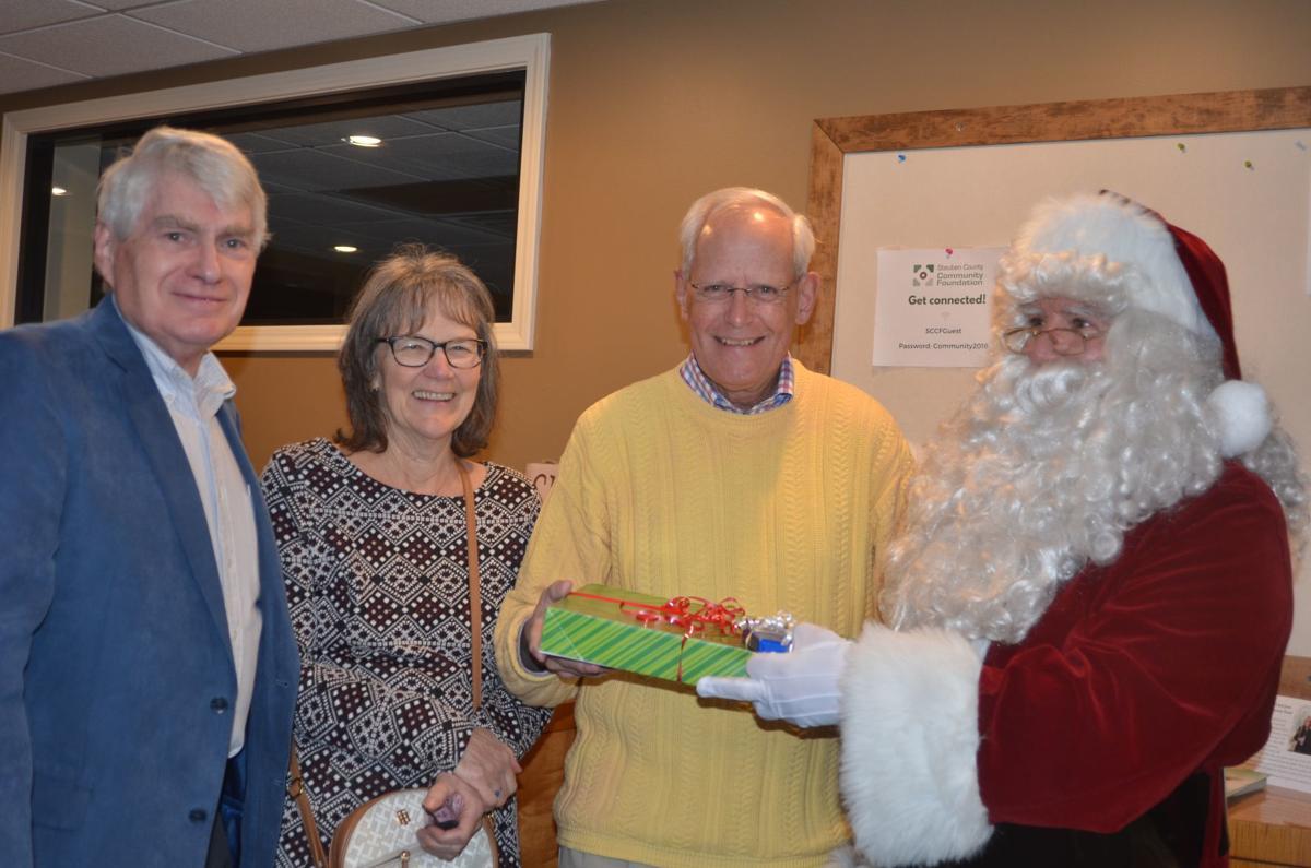 Santa gives gifts