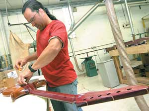 Gold rush Guitar maker Grem USA may buy nanotech company, but local production has yet to take off