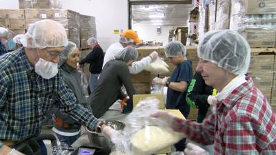 Local Interfaith Group Volunteers at Food Bank