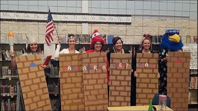 Teachers dressed as border wall