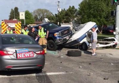 Truck lands on boat in Idaho Falls crash | Local News | kpvi com