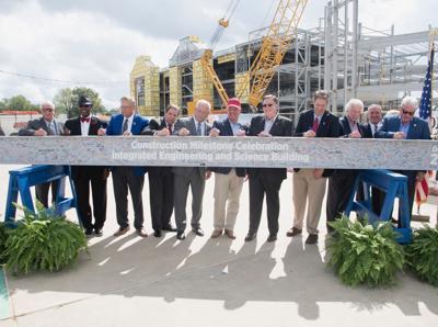 Engineering building beam signing-Gov John Bel Edwards.