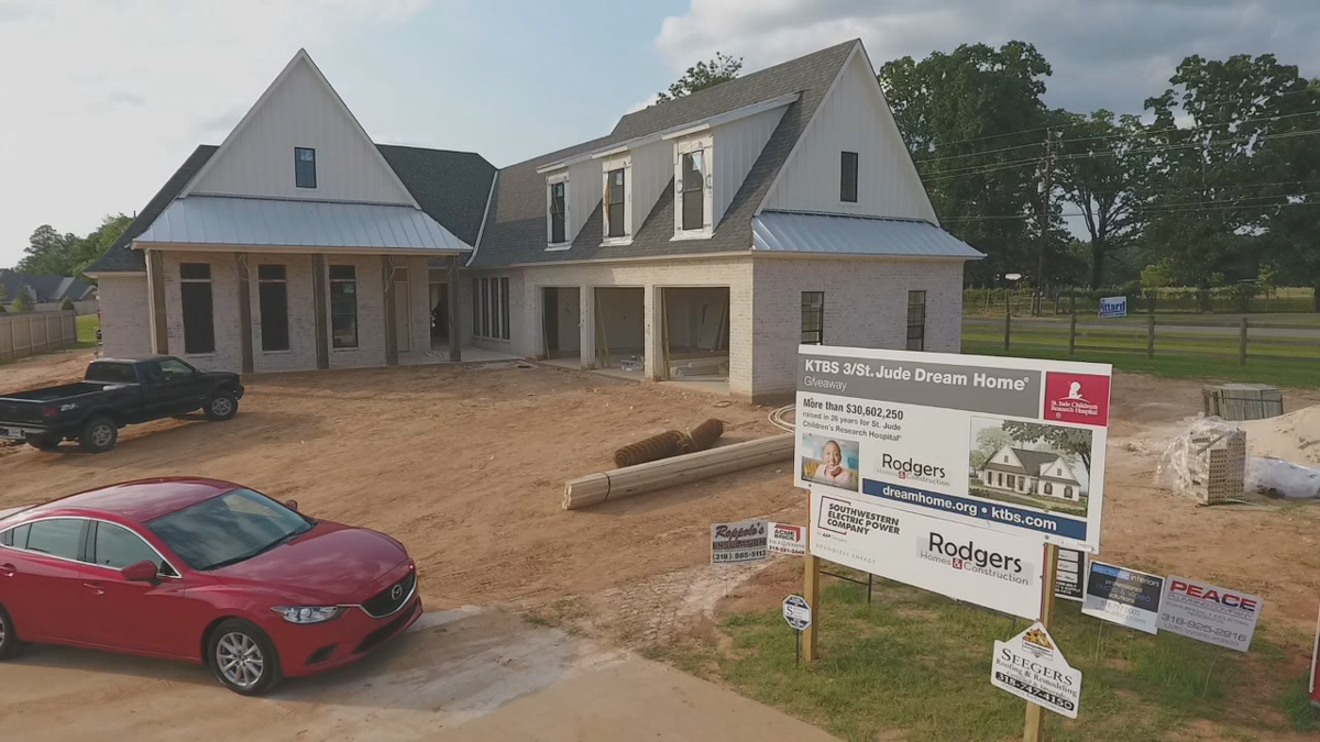 Wide shot of home, car and sign.png