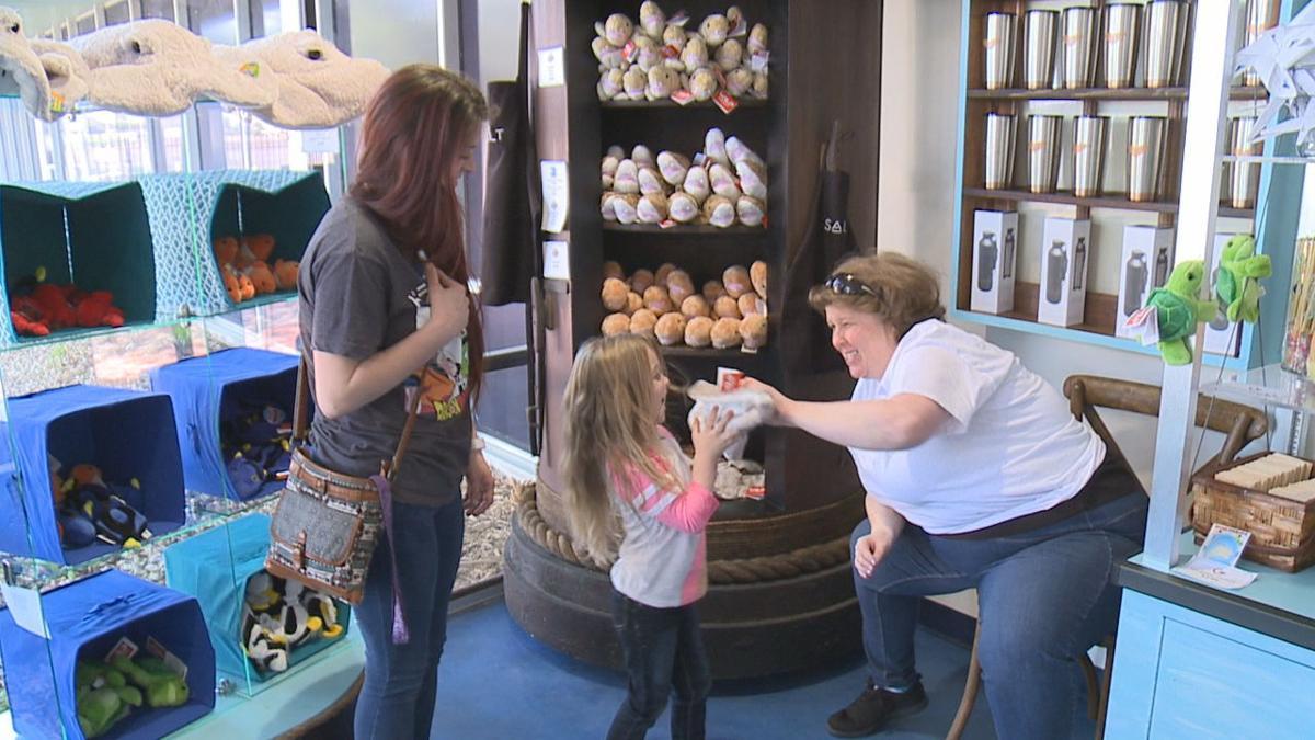 Amy Waites in aquarium gift shop