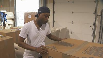 Colinzio Bell working in warehouse