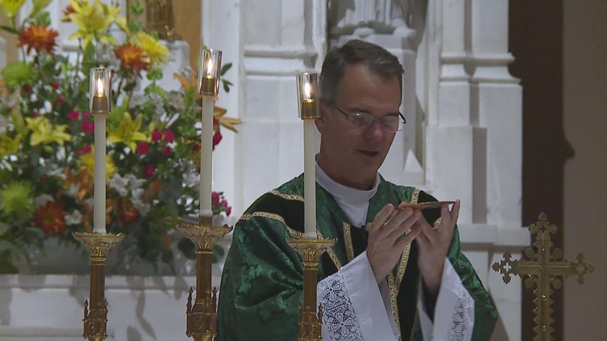 Rev. Peter Mangum leads Saturday evening mass.jpg