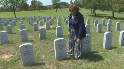 Marie Hines at grave site of husband William Hines
