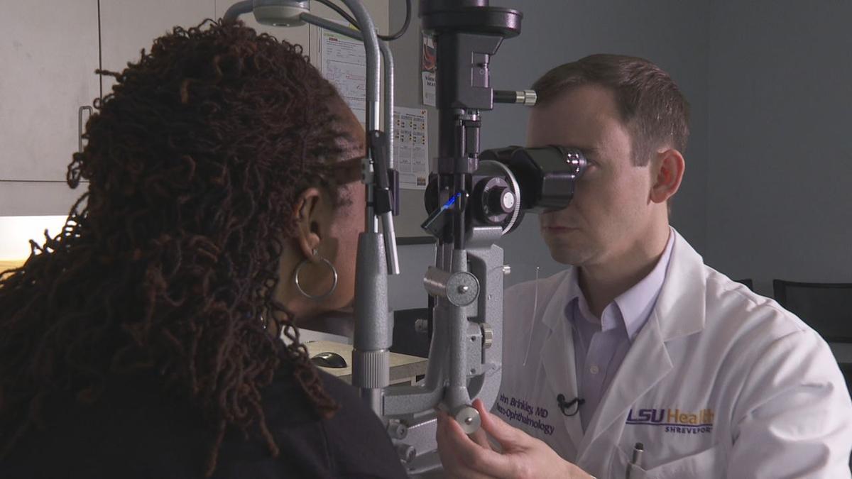 Dr. Brinkley examines eyes.jpg