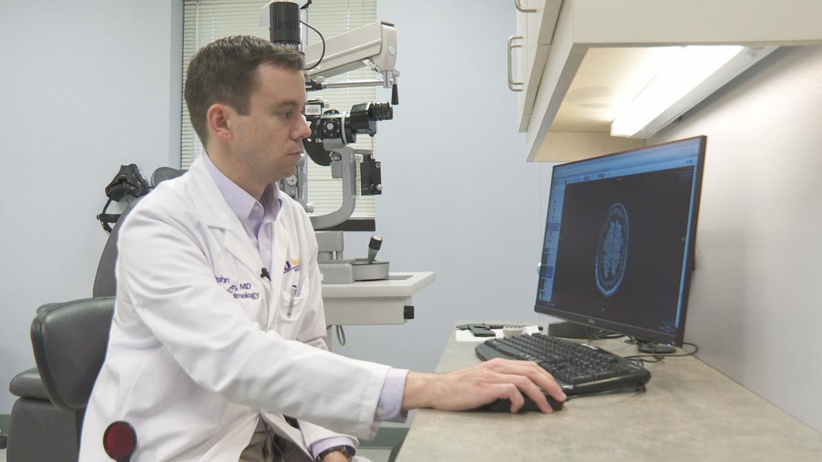 Dr. Brinkley examines patients skull .jpg