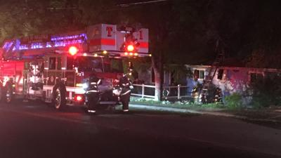 Investigation underway after fire burns hole in home roof, engulfs camper in Billings