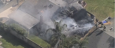 1 dead after a small plane crashes into a home