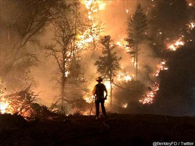 A firefighter securing an active area of California's Camp Fire