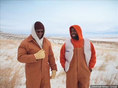 "Kanye West and his father in the music video ""Follow God"""