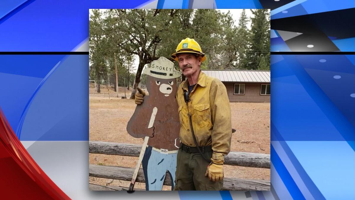 Dan Steffensen with Smokey Bear sign