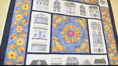 Woman spends 2 years making quilt using 17,000 crystals, donates it for a good cause