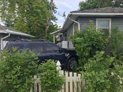 Vehicle strikes house on Billings West End