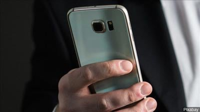 Phone, person holding phone