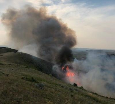 Firefighters battle 2 fires on Crow Reservation amid temperatures topping 100º