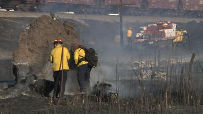 Grass fire near Exxon Mobile temporarily closes Lockwood Rd.