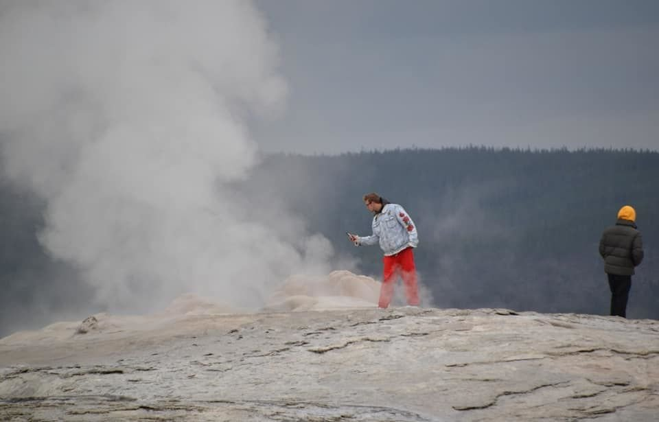 yellowstone national park old faithful geyser walker