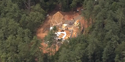 House under construction collapses and kills two people