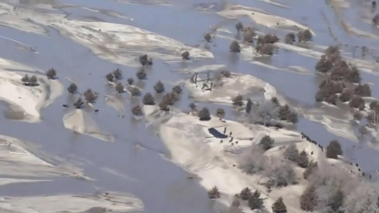 WATCH: Nebraska Army National Guard drops hay from Chinook