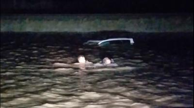 Motorist trapped by flood waters calls rescue a miracle