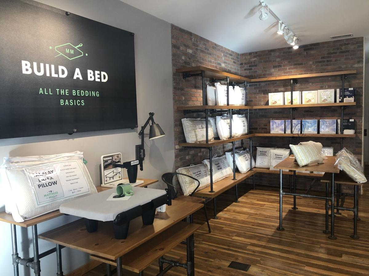 "The ""Build A Bed"" section in the Mattress Mill showroom."