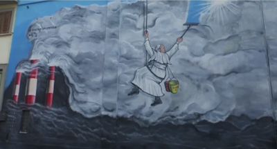 Pope Francis shown an art work of him cleaning the sky after speaking about climate change