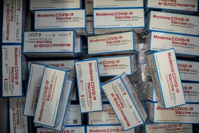 FDA vaccine advisers are meeting to consider Moderna Covid-19 vaccine boosters