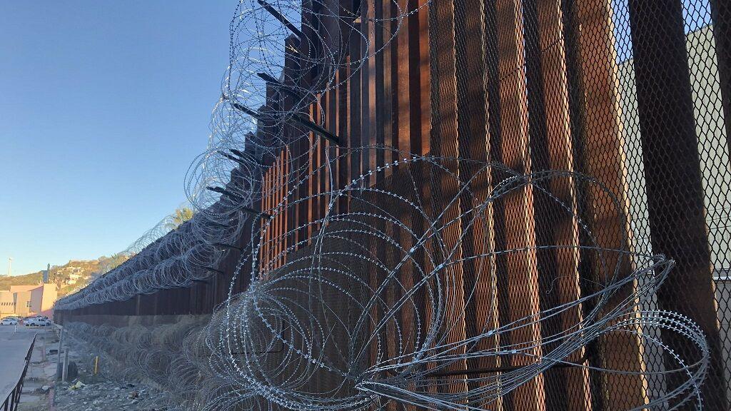 Razor wire still attached to Nogales border fence